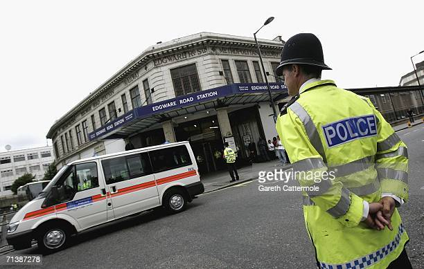 A police officer observes a 2 minute silence to remember the victims of 7/7 bombings at Edgware Road Station station on July 7 2006 in London England...