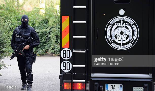 A Police officer of the GIPN keeps a watch on a security van containing drugs before destroying them in an incineration plant on July 12 2011 in...