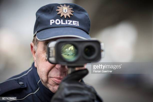 Police officer operates a speedometer during a traffic control in Berlin on February 27, 2018 in Berlin, Germany.