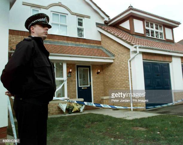 A police officer outside the house Camberley in Surrey where the bodies Anthony Smith a former sergeant in the British Army his wife Kay and their...