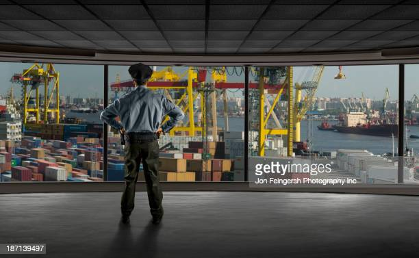Police officer overlooking shipyard