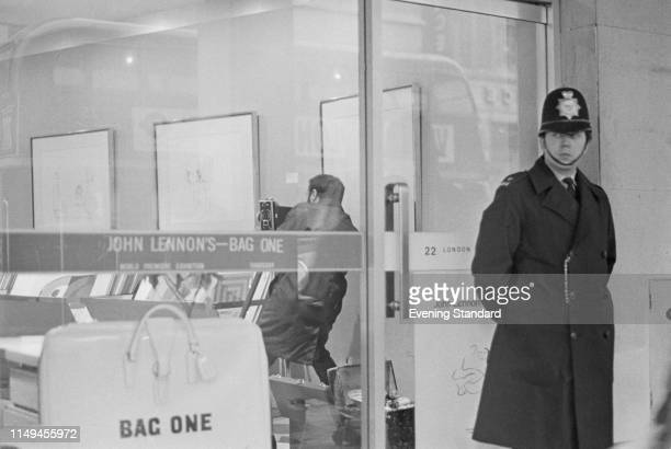 Police officer patrolling the Bag One exhibition by John Lennon at the London Arts Gallery on New Bond Street after the Scotland Yard confiscated 14...