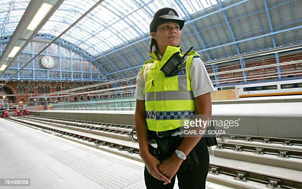 Police officer patrols a platform at Saint Pancras station in north London, 04 September 2007. A Eurostar train shattered the record for the quickest...