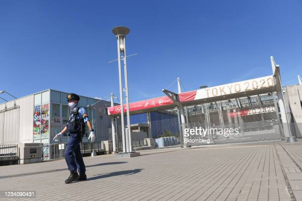 Police officer patrols around Ajinomoto Stadium, ahead of an opening round women's football match between the U.S. And Sweden, at the Tokyo 2020...