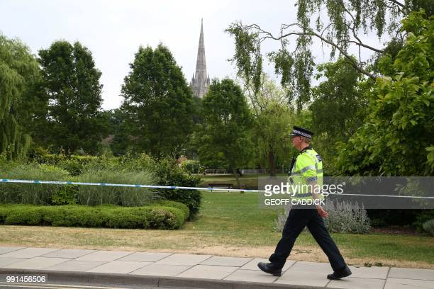 A police officer patrols at a cordon outside Queen Elizabeth Gardens in Salisbury southern England on July 4 2018 believed to be cordoned off in...
