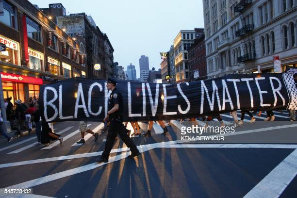 TOPSHOT A police officer patrols during a protest in support of the Black lives matter movement in New York on July 09 2016 The gunman behind a...
