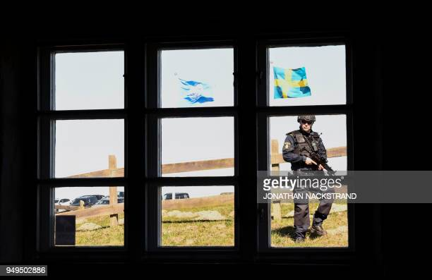 A police officer patrols during the annual informal working meeting with the UN Security Council on April 21 2018 at Dag Hammarskjold's farm at...