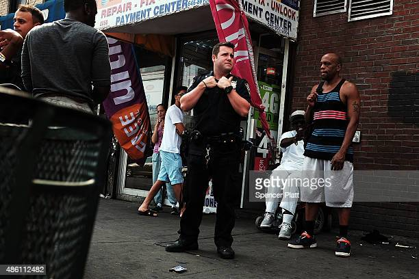 Police officer patrols in an area which has witnessed an explosion in the use of K2 or 'Spice', a synthetic marijuana drug, in East Harlem on August...