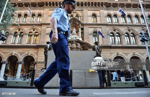A police officer patrols in front of Sydney Cenotaph in Martin Place on April 24 2017 on the eve of ANZAC day Dawn services will be held across the...