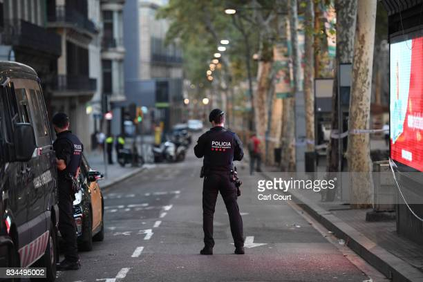 A police officer patrols on Las Ramblas following yesterday's terrorist attack on August 18 2017 in Barcelona Spain Thirteen people were killed and...
