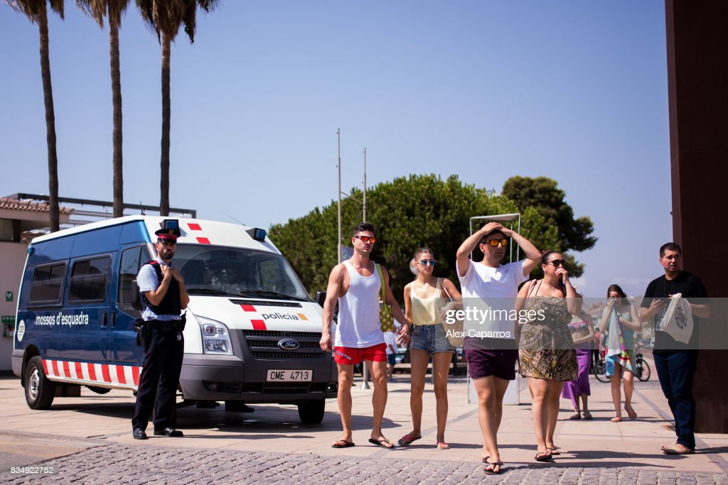 A police officer patrols on the spot where five terrorists were shot by police on August 18, 2017 in Cambrils, Spain. Fourteen people were killed and dozens injured when a van hit crowds in the Las Ramblas area of Barcelona on Thursday. Spanish police have also killed five suspected terrorists in the town of Cambrils to stop a second terrorist attack.