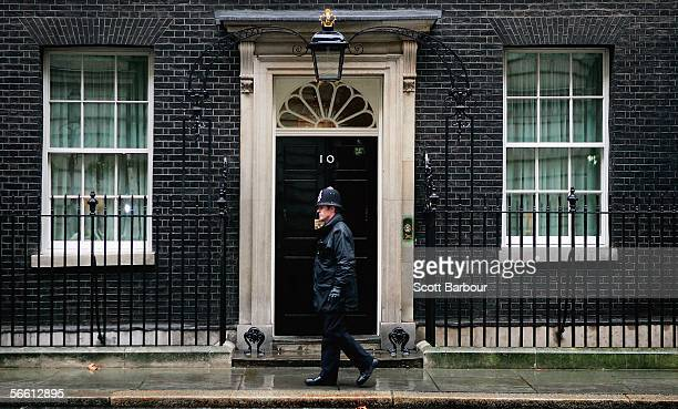 A police officer patrols outside of the official residence of Britain's Prime Minister Tony Blair at Downing Street on January 18 2006 in London...