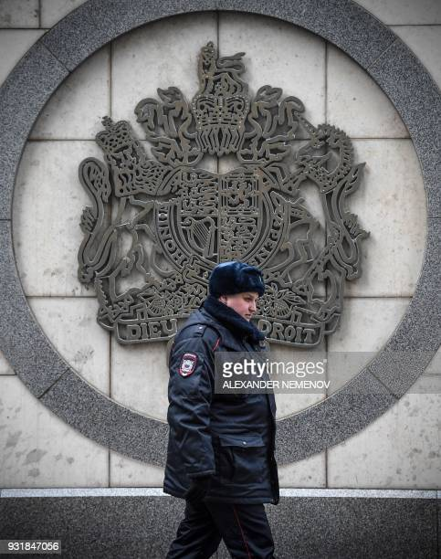 A police officer patrols outside the British embassy building in Moscow on March 14 2018 Britain will expel 23 Russian diplomats over the nerve agent...