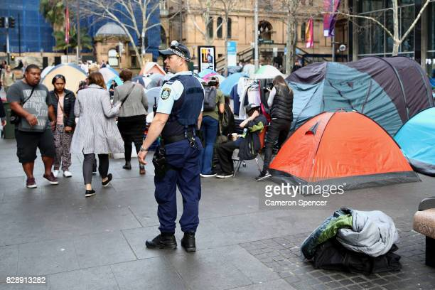 A police officer patrols tents at Martin Place on August 10 2017 in Sydney Australia The NSW Government passed a new bill on Wednesday giving police...