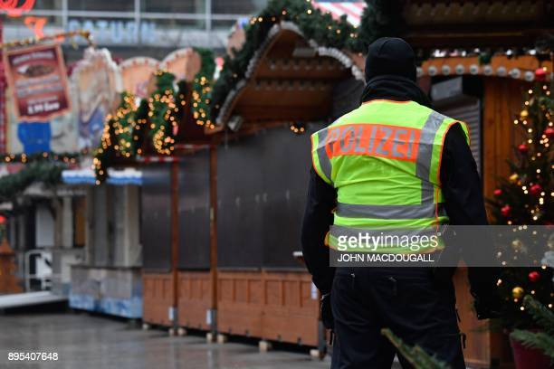 A police officer patrols the closed Christmas market on the sidelines of the inauguration of the memorial for the victims of the 2016 deadly truck...