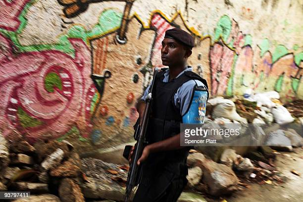 """Police officer patrols the recently """"pacified"""" Babilônia slum, or favela, on December 3, 2009 in Rio de Janeiro, Brazil. Babilônia is one of a number..."""