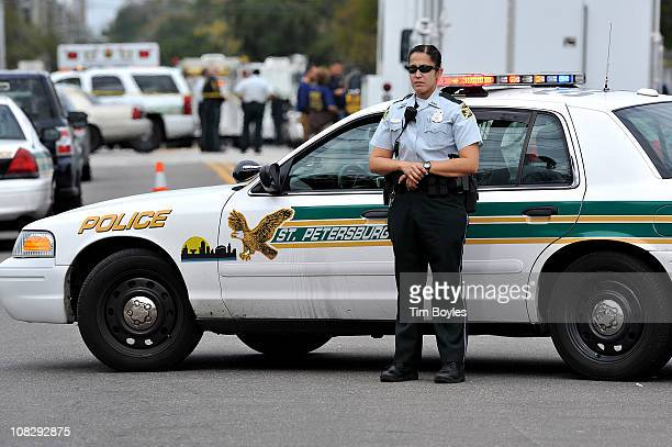 Police officer patrols the scene of a shooting that killed two St. Petersburg police officers in Perry Bayview neighborhood January 24, 2011 in St...