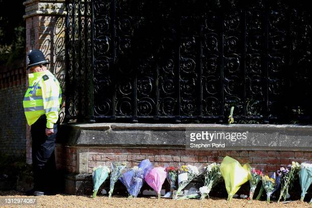 Police Officer pauses for a period of silence outside The Norwich Gates at Sandringham House on April 17, 2021 in Sandringham, Norfolk. The Duke of...