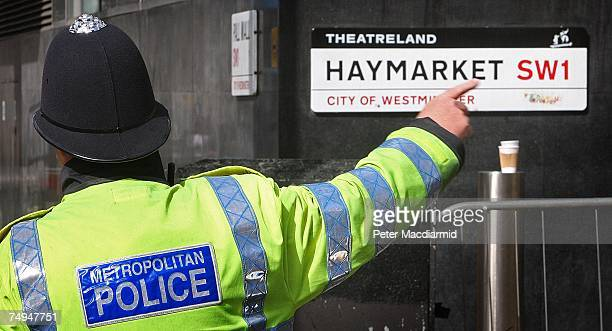 A police officer points near the car suspected of carrying a bomb in Haymarket on June 29 2007 in London England Police were notified shortly after...