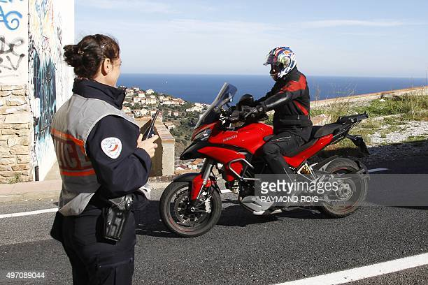 A police officer prepares to perform a control stop at the FrenchSpanish border near Perthus on November 14 2015 European capitals reinforced...