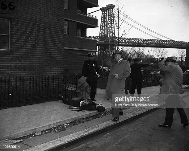 A police officer prepares to put a blanket over body of Robert Chura at Cherry St near East River Drive as detective arrives on scene to question...