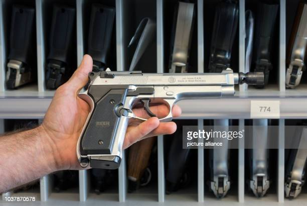 A police officer presents 9mm PAK handgun at the armoury of MecklenburgWestern Pomerania's state bureau of investigation in Rampe Germany 10 April...