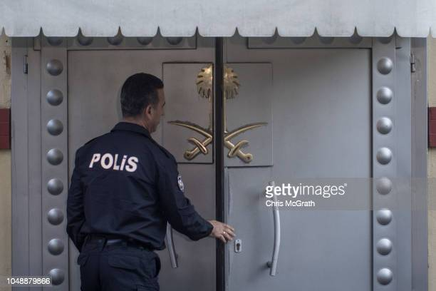 A police officer providing security waits at the front door of Saudi Arabia's consulate on October 10 2018 in Istanbul Turkey Fears are growing over...