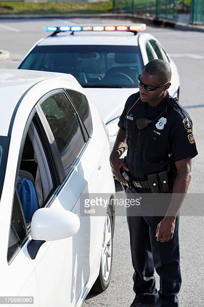 Police officer pulling over driver