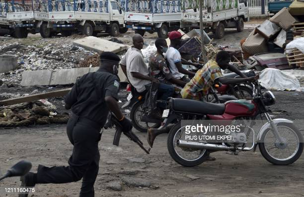 Police officer pursues fleeing motorcycle taxi riders who refused to stop at mounted barricades to check movement of vehicles and for failing to...