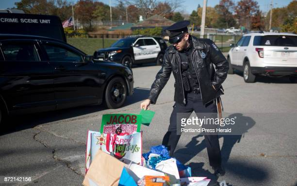 A police officer puts a card for nineyearold Jacob Thompson into one of the boxes being delivered to the Barbara Bush Children's HospitalThompson who...
