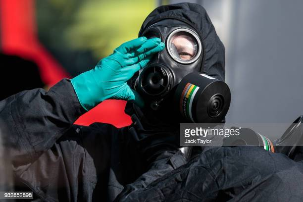 A police officer puts on a protective suit and mask near the scene where former doubleagent Sergei Skripal and his daughter Yulia were discovered...