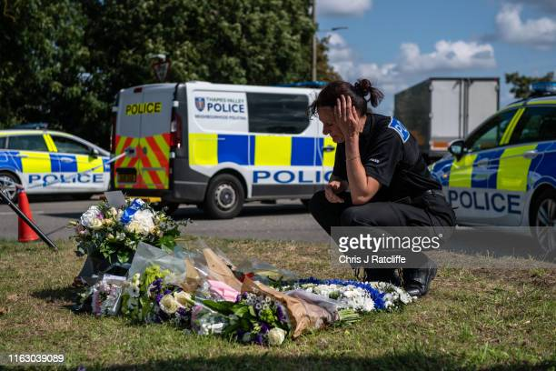 A police officer reacts as she looks at floral tributes left to Police Constable Andrew Harper at the scene where he died on August 21 2019 in...