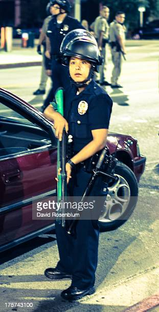 Police officer readies his rifle on Hollywood Blvd. During the demonstration march in Los Angeles, CA against the not guilty verdict of George...