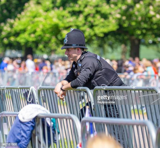 police officer relaxing and chatting with the crowds of people lining windsor great park's 'long walk' to celebrate the marriage of meghan markle and prince harry - meghan stock photos and pictures