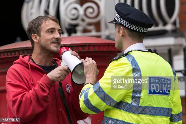 A police officer remonstrates with a protester outside the Ecuadorian Embassy on August 18 2014 in London England Mr Assange has been living in the...