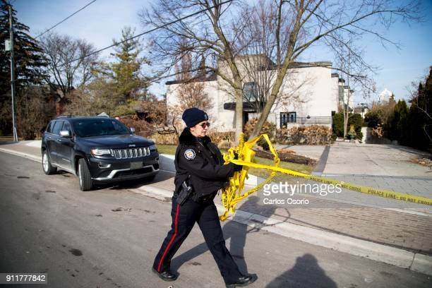 TORONTO ON JANUARY 26 A police officer removes the police tape from the Sherman home Friday morning Toronto police released the home back to the...