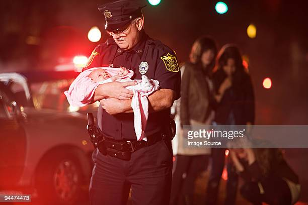 police officer rescuing a baby - rescue stock pictures, royalty-free photos & images