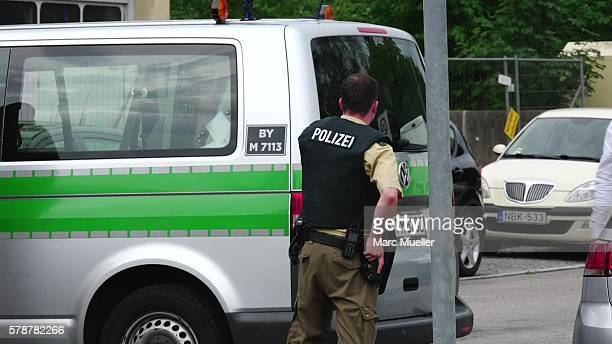 A police officer responds to the shooting at the Olympia Einkaufzentrum at July 22 2016 in Munich Germany According to reports several people have...