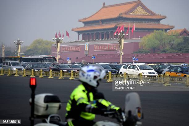 A police officer rides his motocycle patrolling near Tiananmen Square in Beijing on March 27 2018 Speculation intensified on March 27 2018 that North...