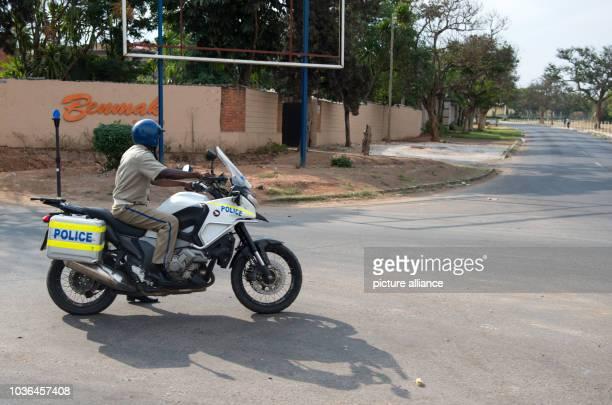 A police officer rides his motorcycle in Lusaka Zambia 20 November 2015 Photo BERNDVONJUTRCZENKA/dpa   usage worldwide