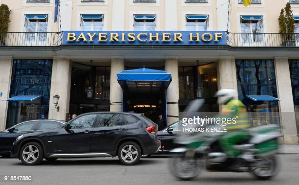 A police officer rides his motorcycle past the hotel Bayerischer Hof the location for the upcoming 54th Munich Security Conference in Munich southern...