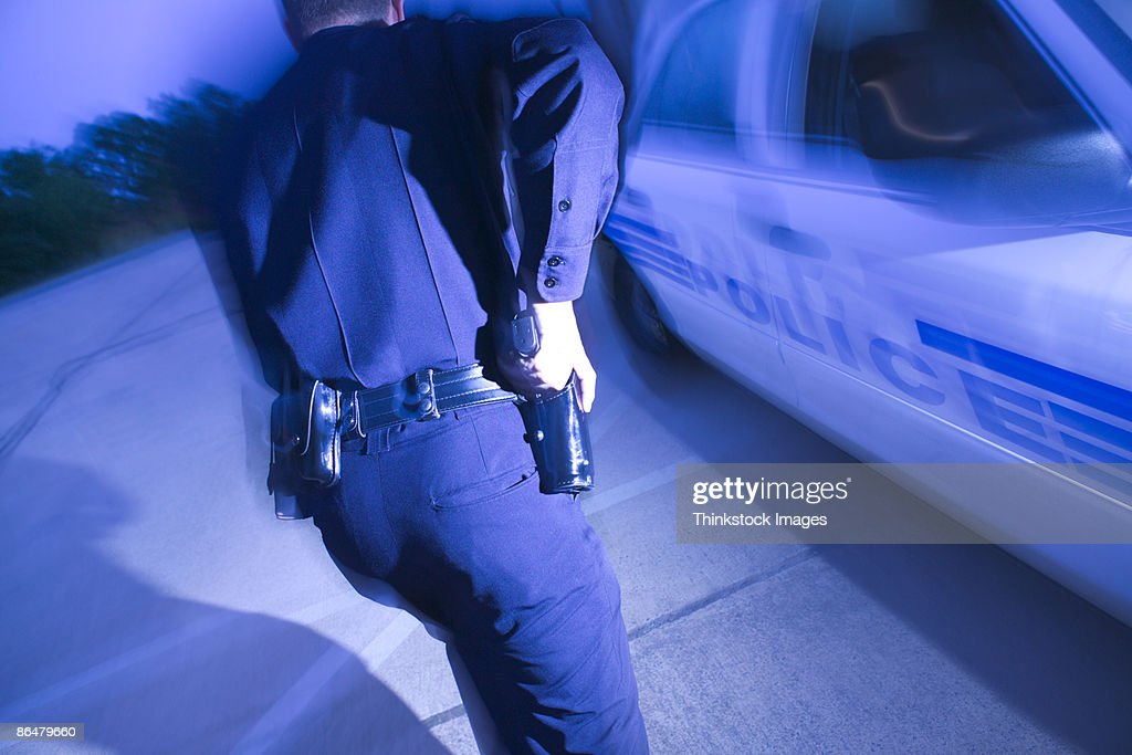 Police officer running : Stock Photo