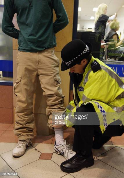 Police officer searches a member of the public after he passed through the Knife Arch scanner temporarily set up by the Metropolitan Police in...
