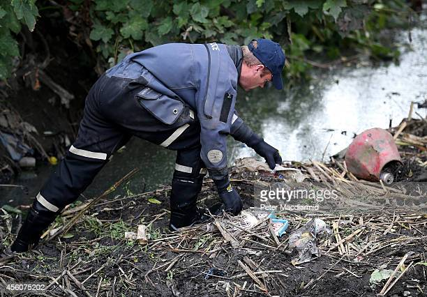 A police officer searches the river Brent for clues in the hunt for schoolgirl Alice Gross on September 25 2014 in London England The hunt for Alice...