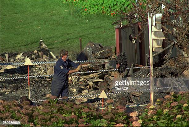 A police officer searches through the ruins of the Seascape Guesthouse burnt down during the Port Arthur massacre 30 April 1996 THE AGE Picture by...