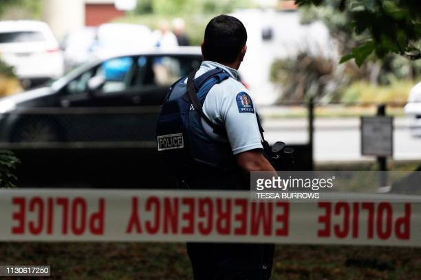 A police officer secures the area in front of the Masjid al Noor mosque after a shooting incident in Christchurch on March 15 2019 Attacks on two...