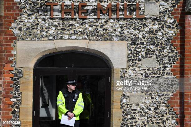 A police officer secures the door of the The Bishop's Mill pub in The Maltings in Salisbury southern England on March 6 2018 in connection with an...