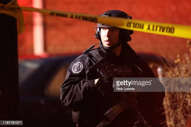 Police officer secures the scene of a shooting that left multiple people dead on December 10, 2019 in Jersey City, New Jersey. In a raging gun battle...