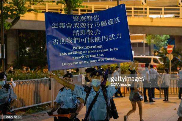 Police officer seen raising an unauthorized assembly flag inside Victoria Park. Police has banned Hong Kongs annual Tiananmen vigil this year citing...