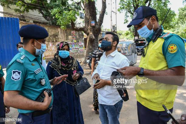 Police officer seen talking to people. Police checkpoints have been set up in various places in the capital to stop unnecessary movement during the...